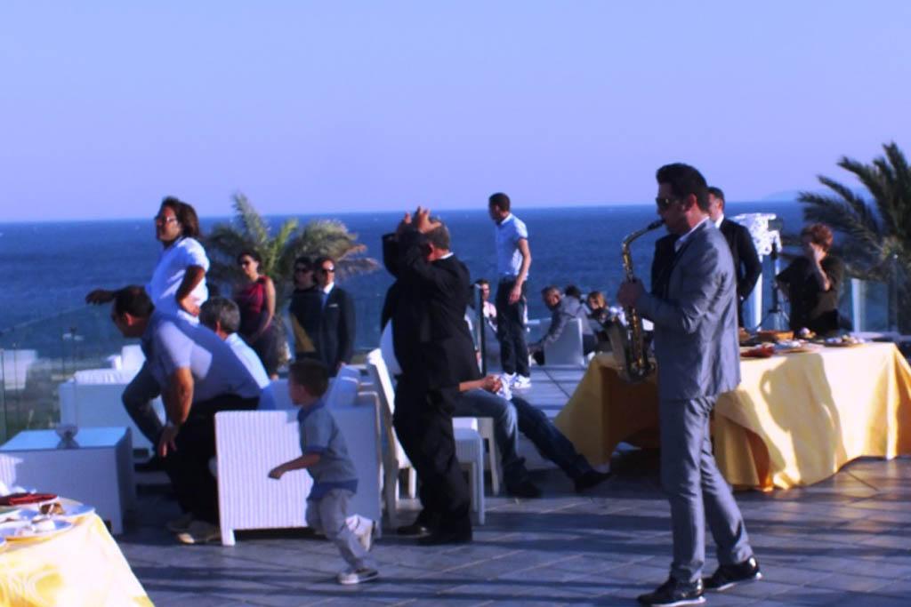Musicisti per la musica con il Sax al Taglio torta presso l'Augustus Resort